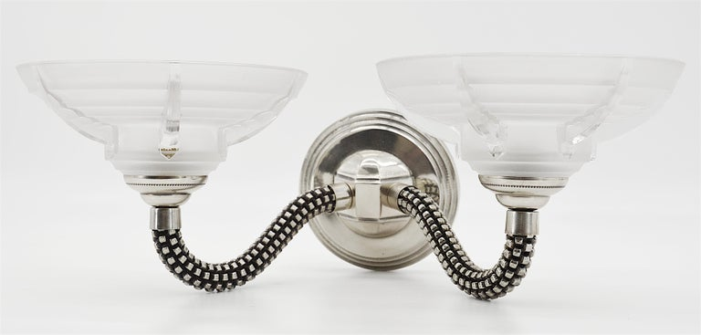 French Art Deco pair of wall sconces by Boris Lacroix (Paris), France, 1930s. 4 thick frosted glass shades by Jean Gauthier the maker of glass shades for Boris Lacroix. Silver plated bronze fixtures. Measures: Each - Height 6.5