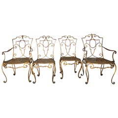 Jean-Charles Moreux Iconic French Moderne Set of Four Gold Gilt Iron Chairs