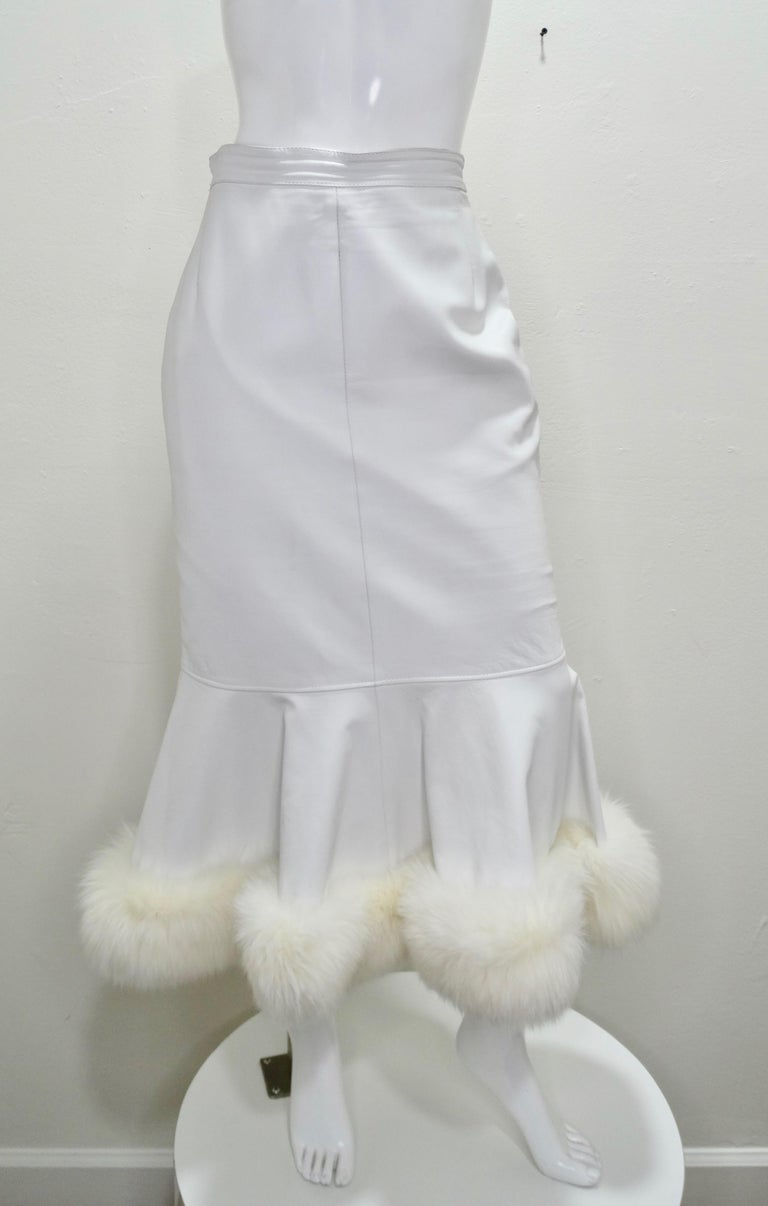 Feel All Of The 80s Vibes In This Leather Skirt! Circa 1980s, this custom couture numbered 10829 Jean Claude Jitrois skirt is crafted from white leather and features a peplum bottom with a fox fur trim and zipper/snap button closure on the back.