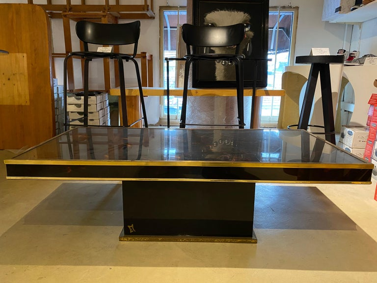 Jean Claude Mahey For Romeo Coffee table lacquer and brass signed Measures: 120 x 60 x 35 circa 1971 1600.