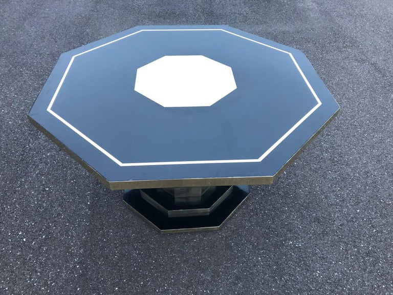 Hexagonal table in back laminate and brass details from the 1970s.