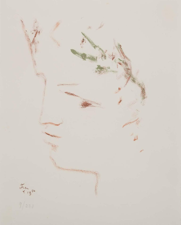 """""""Sous le manteau du feu - portrait of Roman boy's face"""" is an original color lithograph by Jean Cocteau.  Limited edition lithograph from 1954, monographed and dated and numbered on front lower left corner. Edition 277 (9/227). Comes framed in an"""