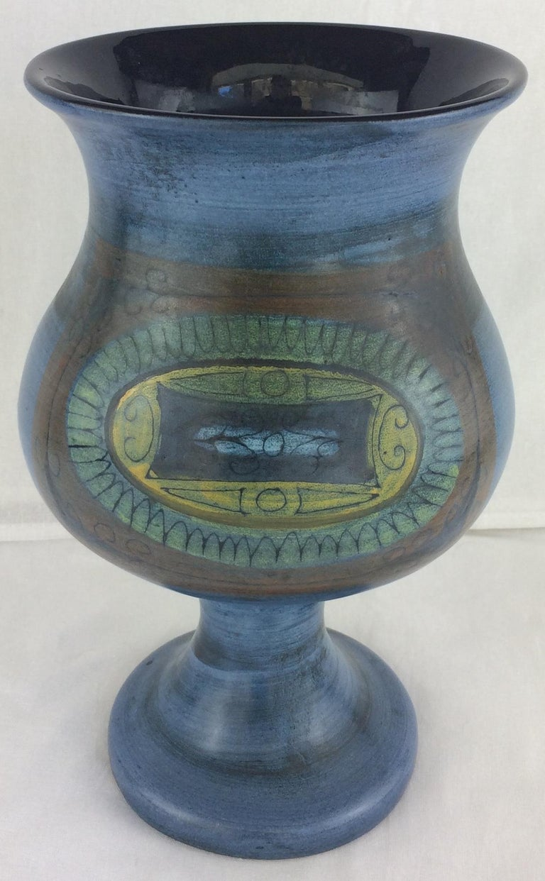 This blue vase is decorated by some stylized friezes on the body of the piece created by Jean de Lespinasse.  Signed.  Resisting on the French Riviera during the Second World War, Jean de lespinasse created with his wife the Socfra produced