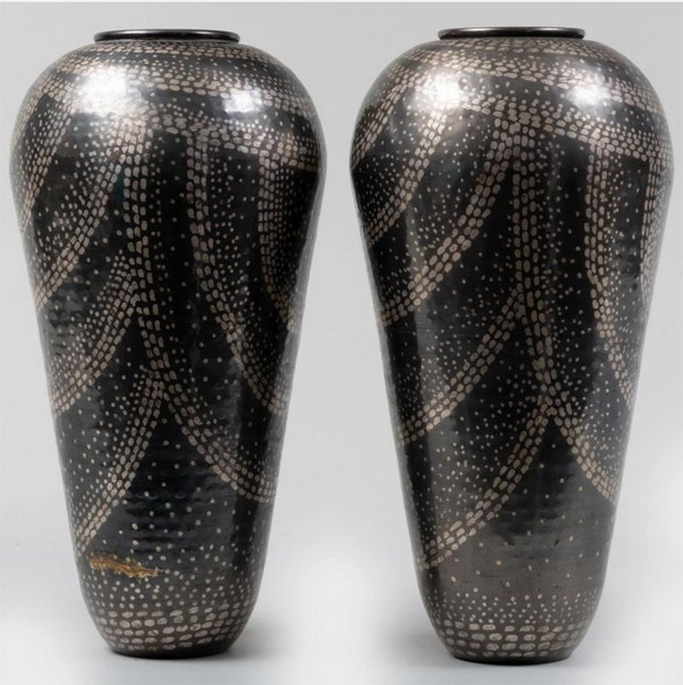 Pair of Jean Dunand like mixed metal vases. Measures: Height 17.5