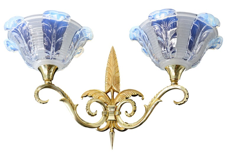 French Art Deco set of 2 double wall sconces by Jean Gauthier, (Paris), France, 1930s. Thick opalescent (cobalt blue) molded glass shade. Solid bronze fixtures. Measures: Each: Height 10.8