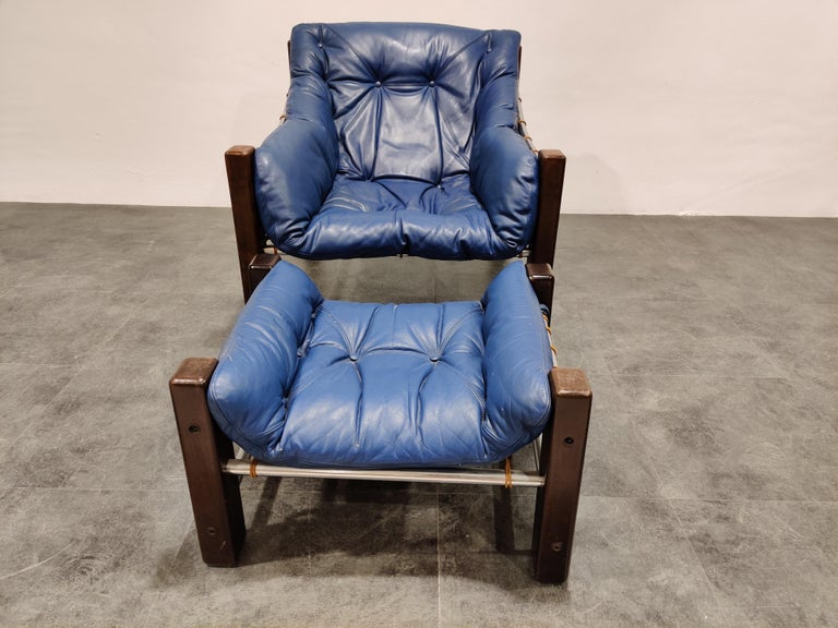 Mid-Century Modern Jean Gillon Blue Leather Captain Chair with Ottoman, 1960s For Sale