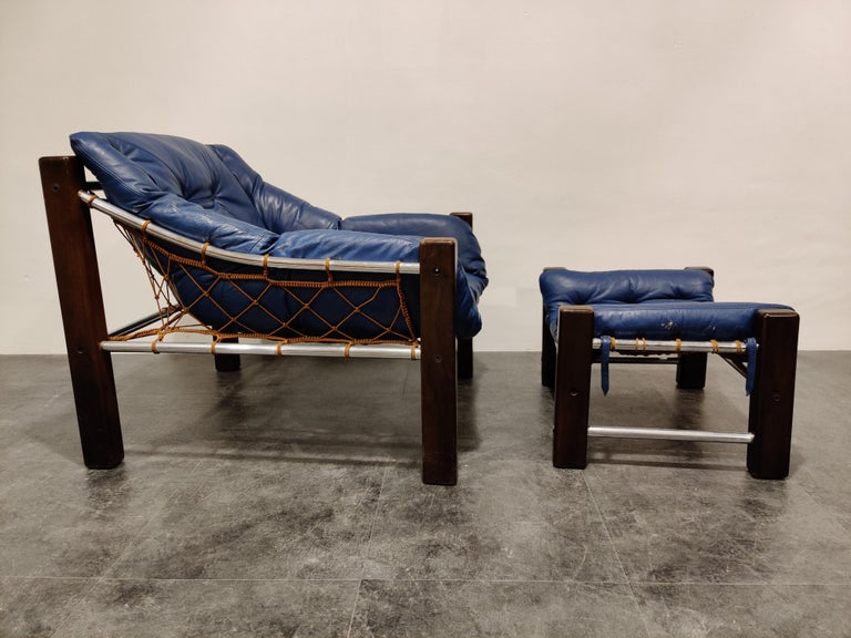 Jean Gillon Blue Leather Captain Chair with Ottoman, 1960s In Good Condition For Sale In Neervelp, BE