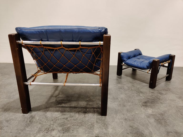Mid-20th Century Jean Gillon Blue Leather Captain Chair with Ottoman, 1960s For Sale