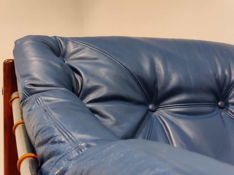 Jean Gillon Blue Leather Captain Chair with Ottoman, 1960s For Sale 1