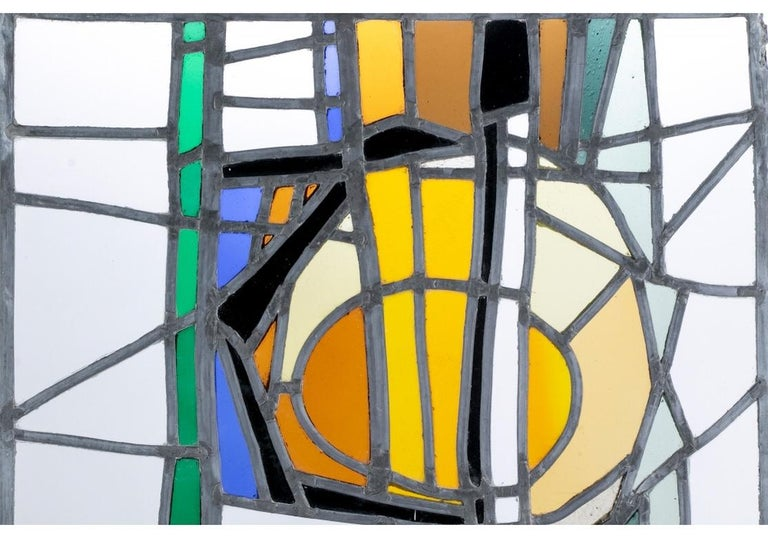 A rare and outstanding piece of stained glass by the French/American (1930-2017) artist Jean-Jacques Duval. Etched signature and N.Y. N.Y. on the clear glass lower right corner. The leaded polychrome abstract glass panel, possibly for a window, is
