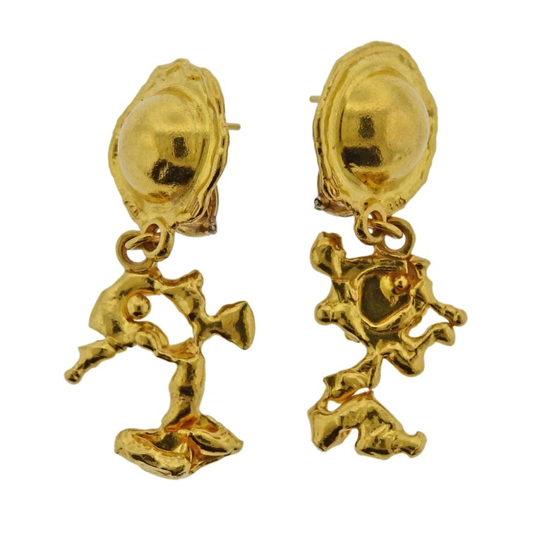 Pair of 22k gold Charming Creatures earrings, crafted by Jean Mahie. Earrings are 53mm x 24mm, weigh 25.9 grams. Marked:  M hallmark, 22k.