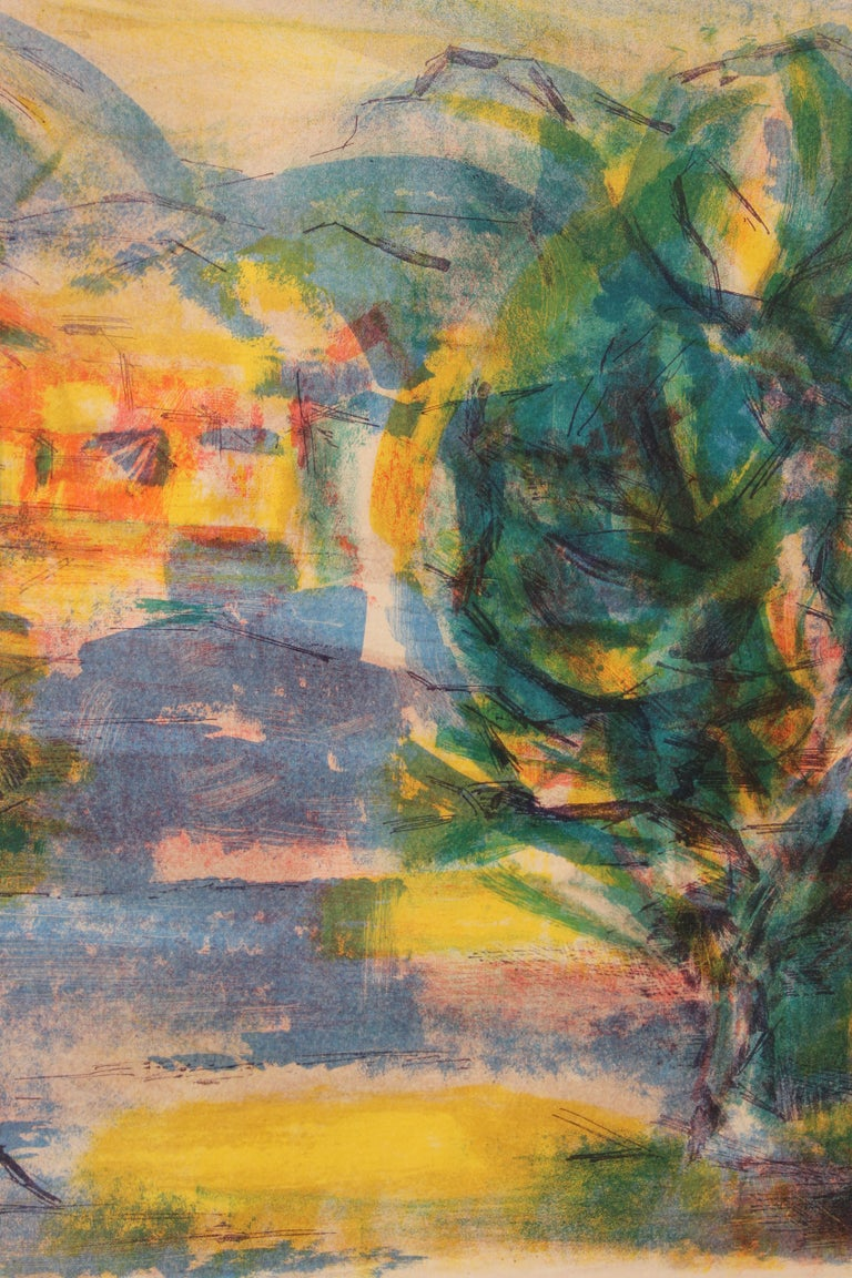French impressionist landscape lithograph by Jean Marzelle (1916 - 2005) who lived and worked in France and was known for painting. The work consists of greens, blues, yellows, and oranges. The print is framed in a wooden frame with a yellow matte.