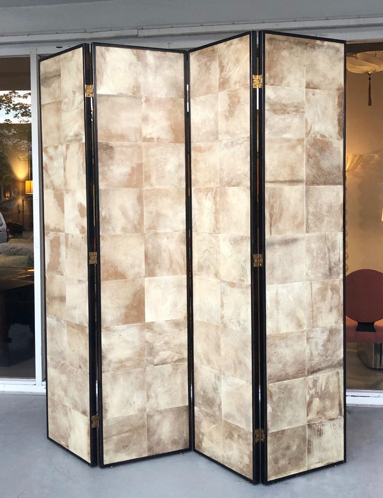 A large 4-piece screen. Wood, covered with parchment squares. Screen is finished on both sides. The hinges allow for the screen to be folded both ways.