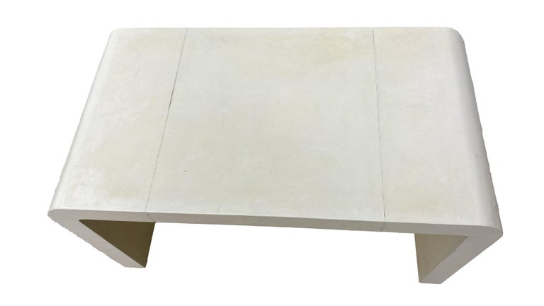 Jean-Michel Frank style waterfall coffee table not signed, but could be an original. It is covered in original goatskin parchment. Beautiful addition to any decor.