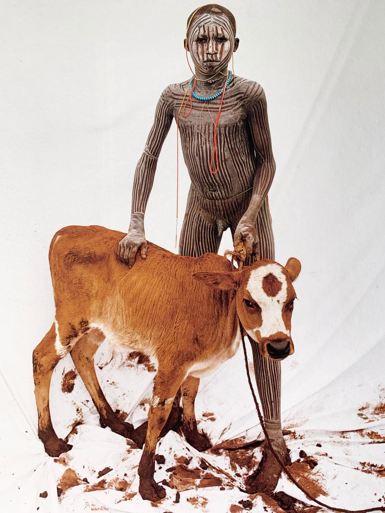 Boy with Calf, Tribal Child in Ethiopia, Africa, Japanese Paper Limited Edition - Photograph by Jean-Michel Voge