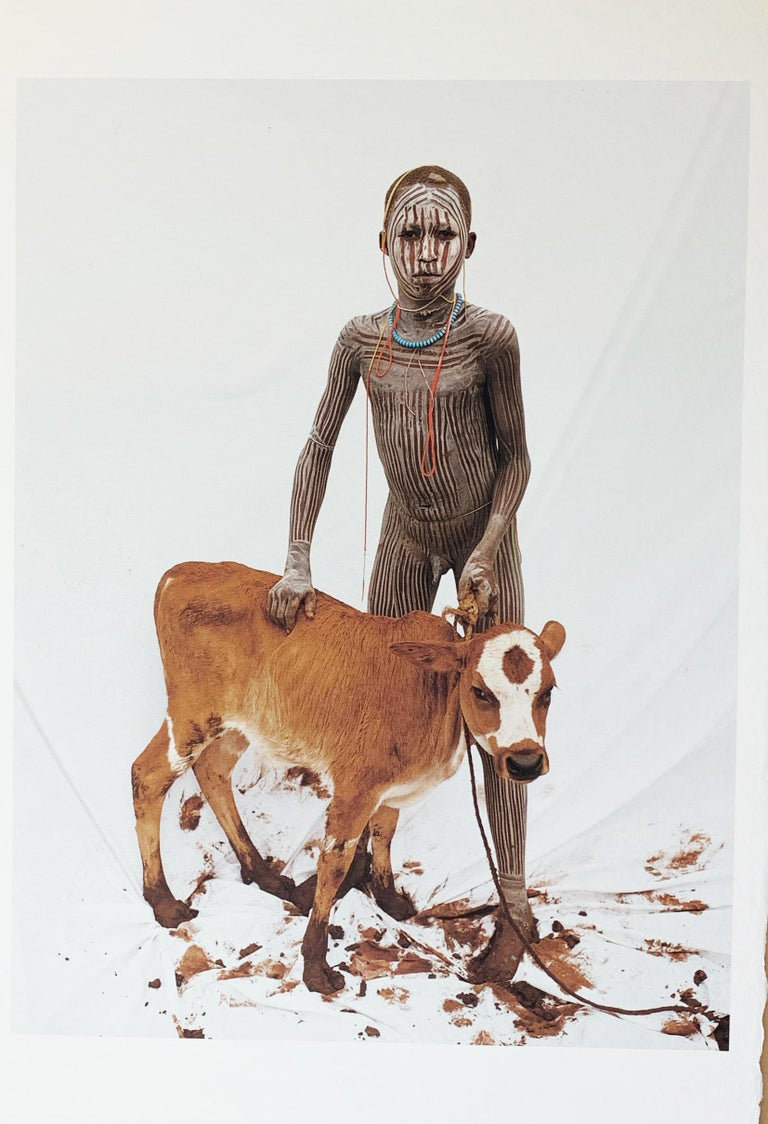 Jean-Michel Voge Color Photograph - Boy with Calf, Tribal Child in Ethiopia, Africa, Japanese Paper Limited Edition
