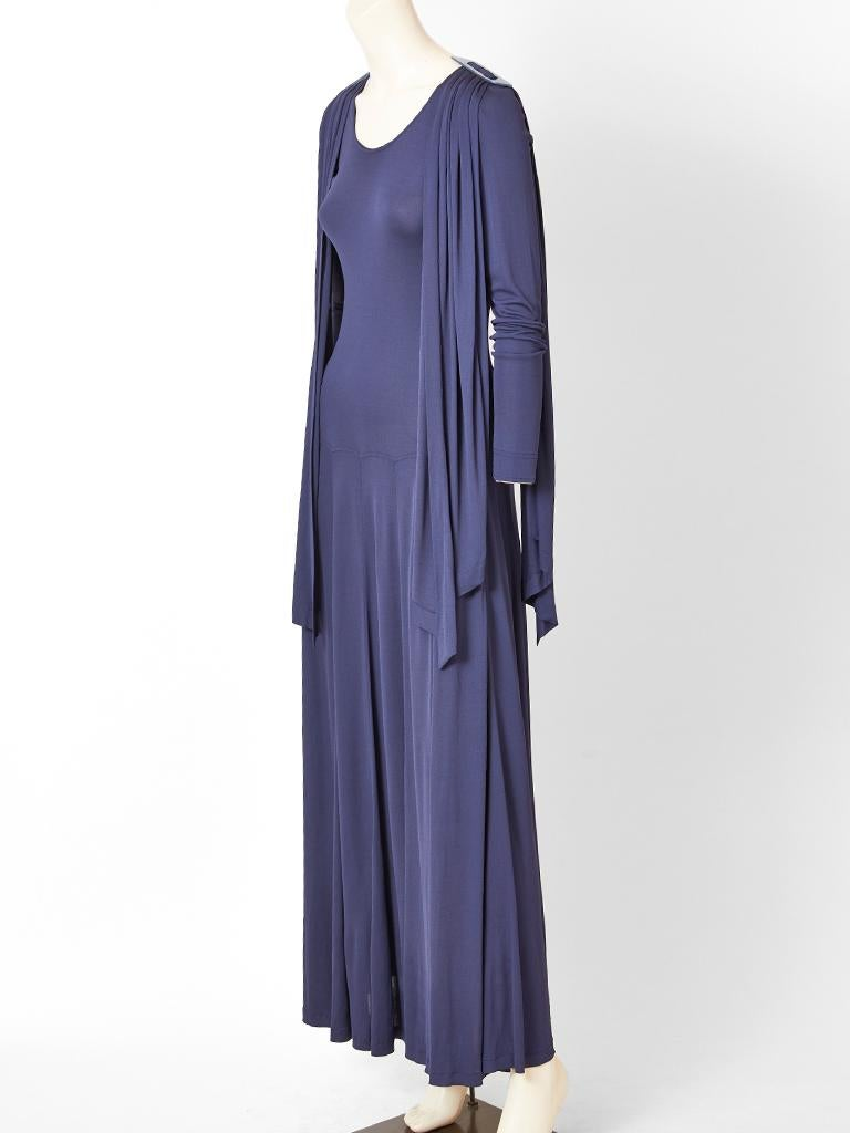Jean Muir, matte jersey, ink blue, maxi dress with attached, gathered panels cascading from the shoulders. Dress has  long sleeves, a rounded neckline, with a fitted, drop waist bodice. Skirt of the dress is gored for fullness. Panels are attached