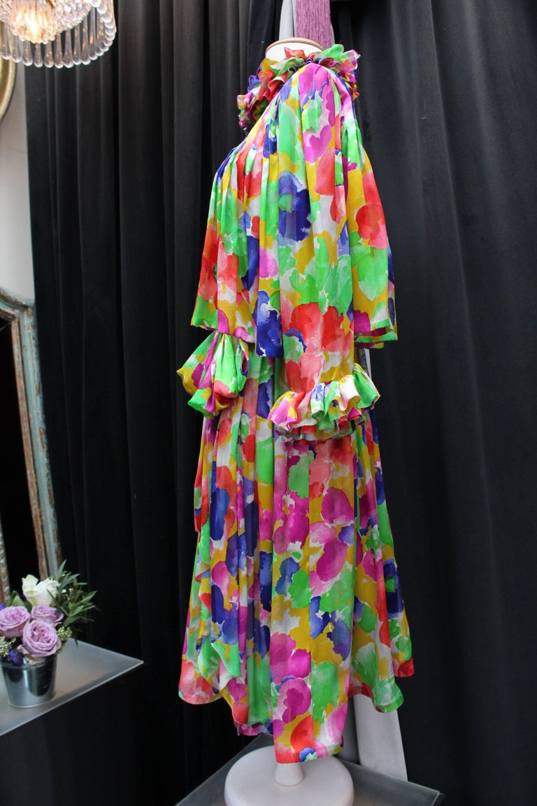 JEAN PATOU HAUTE COUTURE (Made in France) Lovely set comprised of a bustier dress and a short jacket made of silk with floral print in yellow, green, blue, pink and red colors. The jacket features flounces at sleeves and collar, as well as a