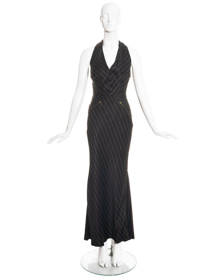 Jean Paul Gaultier black acetate evening dress with contrast stitch stripes, full length zipper at the centre-back, two side zippers and two front zipper pockets.  Spring-Summer 1995
