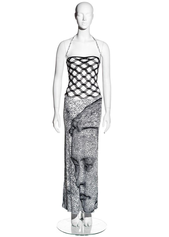 ▪ Jean Paul Gaultier black and white fishnet lycra maxi dress ▪ Black fishnet bodice ▪ Lycra maxi skirt with digital face print  ▪ Optional halter neck  ▪ Size Medium ▪ Spring-Summer 2001