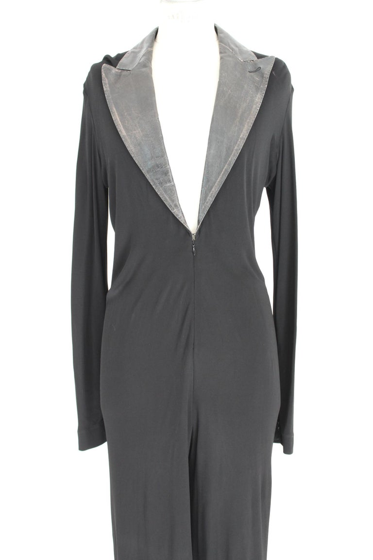 Jean Paul Gaultier elegant jumpsuit in soft rayon. Neck with leather reverse. Sensual neckline along the chest with zip closure. The jumpsuit has a soft fit. This jumpsuit is suitable for formal events such as gala dinners, elegant evenings and