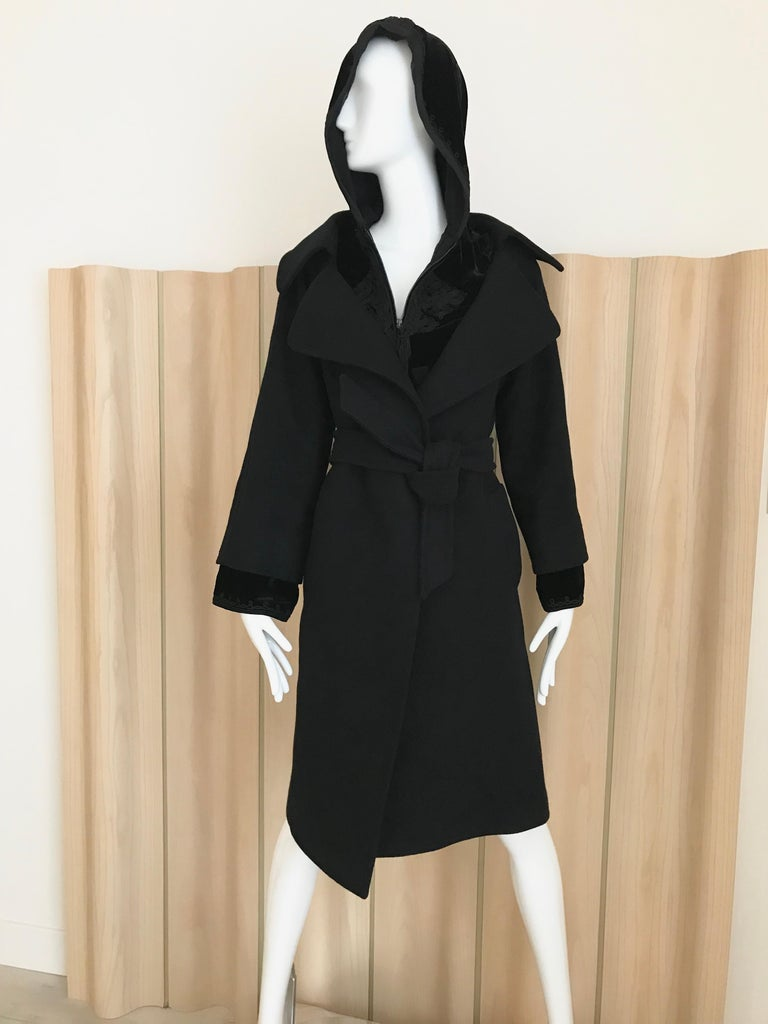 Vintage Jean Paul Gaultier Black wool coat with velvet inner layer with zipper and hood. Fit size: Modern US 6 Bust: 38 inches/ Hip 40 inches/ Coat length 39 inches/ sleeve length: 24 inches