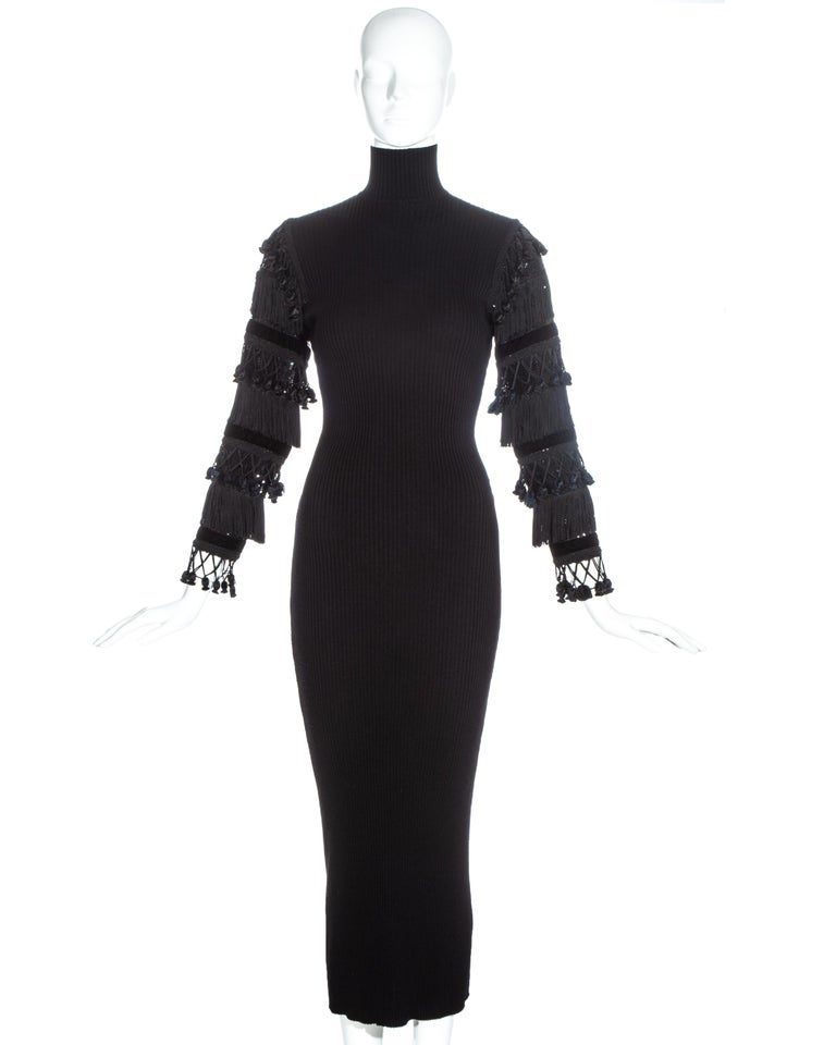 Jean Paul Gaultier black ribbed wool turtle neck maxi dress with velvet, sequin and tasseled sleeves.  Fall-Winter 1985