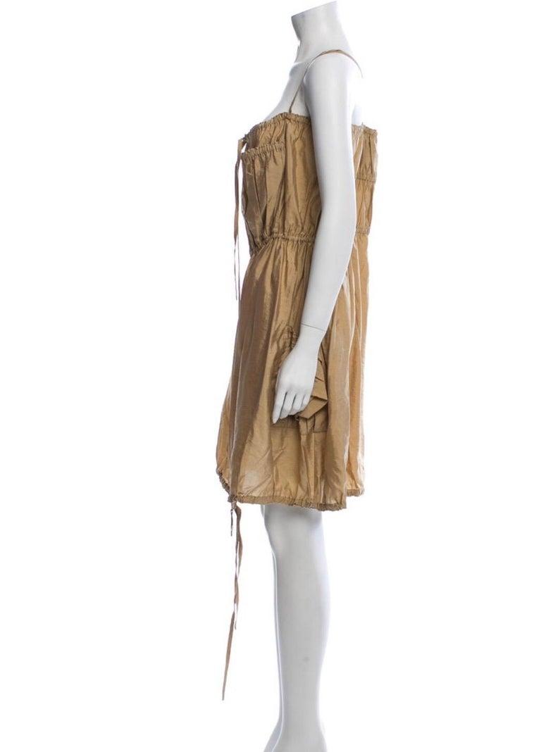 Jean Paul Gaultier Classique silk dress with zipper, drawstrings and cross cross straps. Condition Excellent. Size M / US 6 / IT 42 Waist: 30