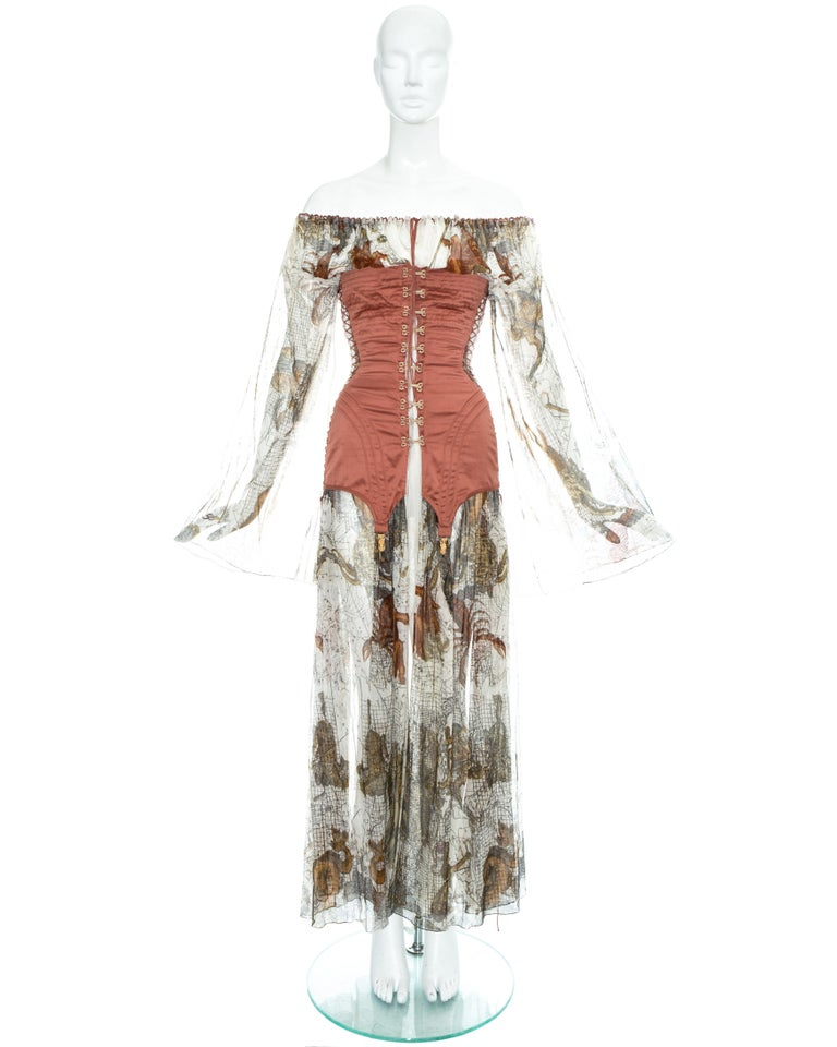 Jean Paul Gaultier 'Joan of Arc' dress made with a map printed cotton muslin with an appliquéd corset to the bodice, lace up fastening on the sides and back with hook and eye closures on the front. The dress is worn off-shoulder using the string