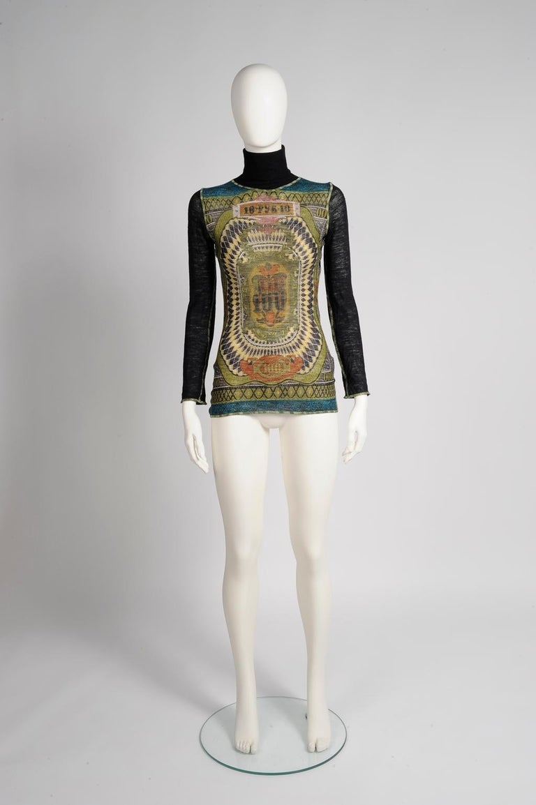 Modelled by Kate Moss on the Fall-Winter 1994-1995 runway in another color range (see pictures 3 & 4), this Jean-Paul Gaultier turtleneck sweater top is cut for a close fit. Made of 100% lightweight stretchy wool mesh, it has the recognizable (and