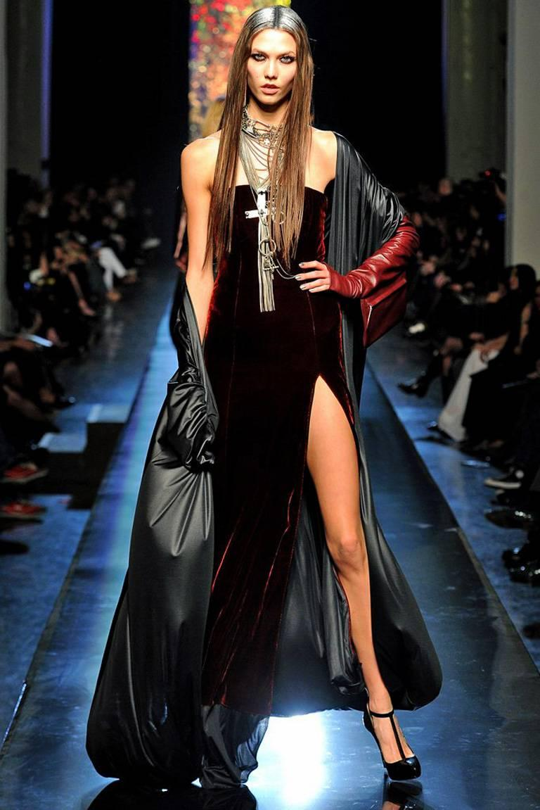 Unusual and dramatic Jean Paul Gaultier gown with attached evening coat/evening dress.    Featured on the runway of the 2012 F/W collection.  Fashioned of black velvet in a strapless sheath with thigh high slit. Long evening coat is attached to the