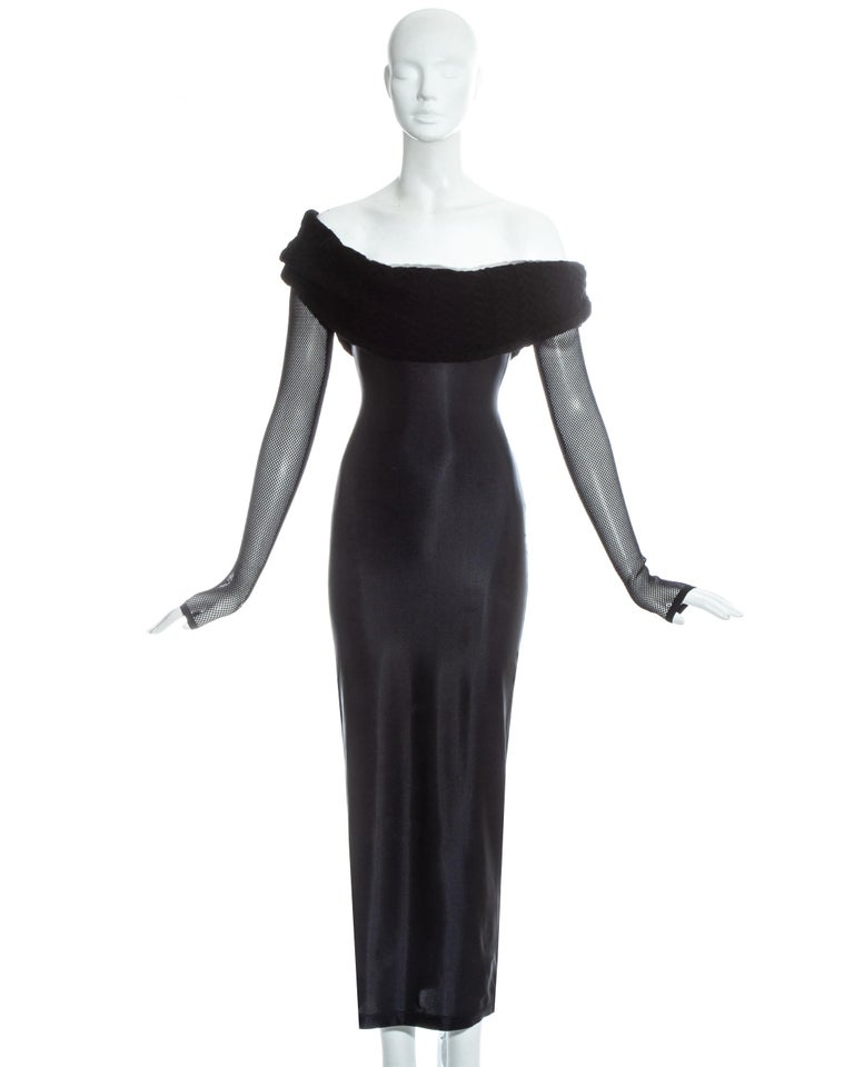 Jean Paul Gaultier, Equator black lycra figure hugging maxi dress with fishnet mesh sleeves and oversized shawl collar. The dress also has a built in tulle ruffles in the bust which can be hidden or shown.   c. early 1980s