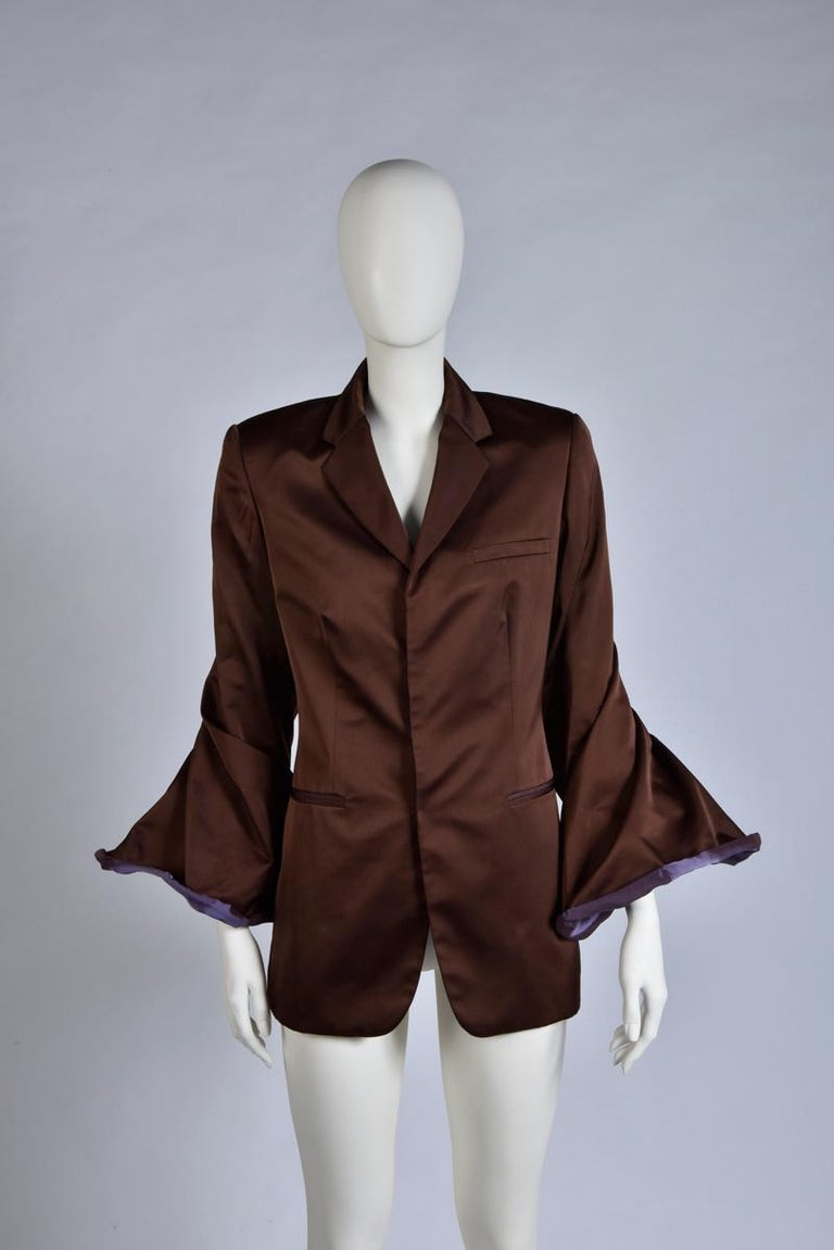 With its two tones (eggplant/dark purple) colors versatile bell sleeves, this vintage Jean Paul Gaultier evening blazer will really make an impact. Tailored from lustrous shifting satin, the jacket has a slightly loose fit. Fully lined for an easy