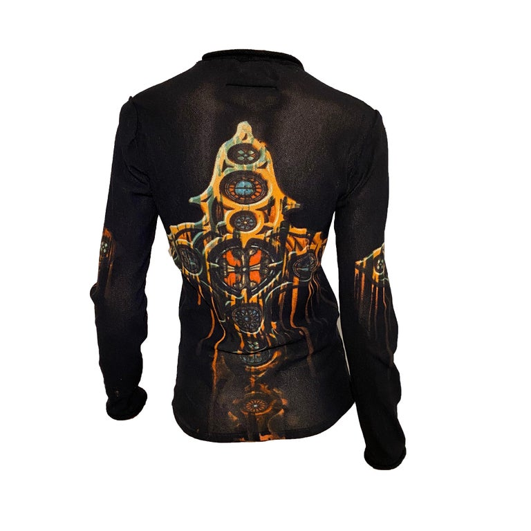 Jean Paul Gaultier Fall/Winter 1998 Black Mesh long sleeve top with Red/Orange Gothic Cross motif both on front and back, black wool crewneck and cuffs.  Materials: 89% Polyamide Nylon, 11% Wool
