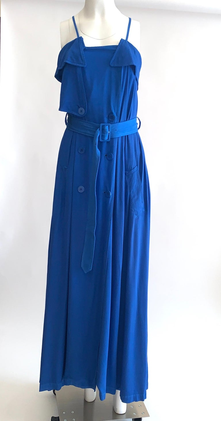 Jean Paul Gaultier Femme blue maxi dress with trench coat detailing. Thin straps can be unsnapped at back to create a criss-cross or halter style.   Buttons up front. Adjustable belt. Side pockets.  100% rayon.  Made in Italy.  Size It 40, US