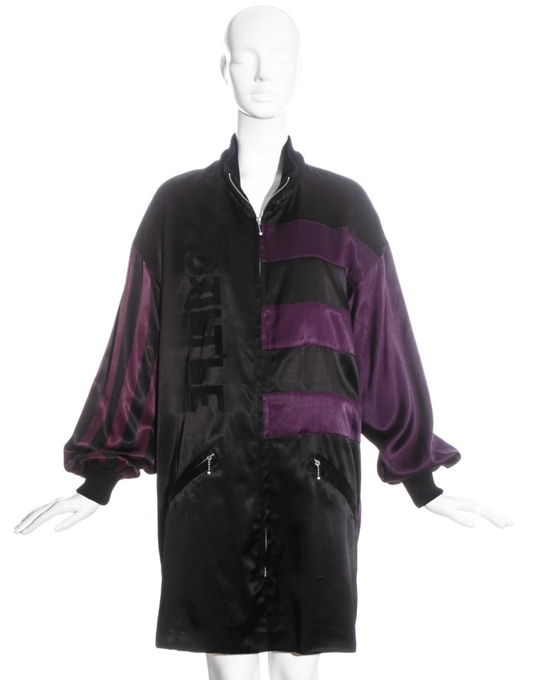 Jean Paul Gaultier purple and black striped satin oversized jacket with ribbed wool cuffs and collar, two front pockets and zip fastenings.  Fall-Winter 1986