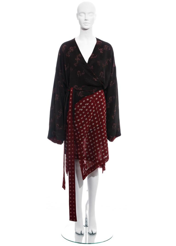 ▪ Jean Paul Gaultier reversible kimono style wrap jacket ▪ 73% Rayon, 27% Triacetate  ▪ Wide sleeves  ▪ Two front pockets on both sides  ▪ Long waist belts  ▪ IT 42 - FR 38 - UK 10 - US 6 ▪ Fall-Winter 1994