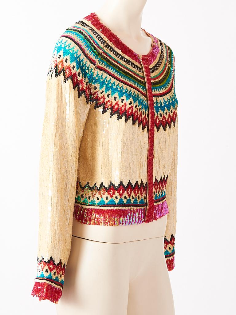 Jean Paul Gaultier, fair Isle, inspired pattern, cardigan totally encrusted in multi tone sequins on an ivory ground. Hidden front snap closures.