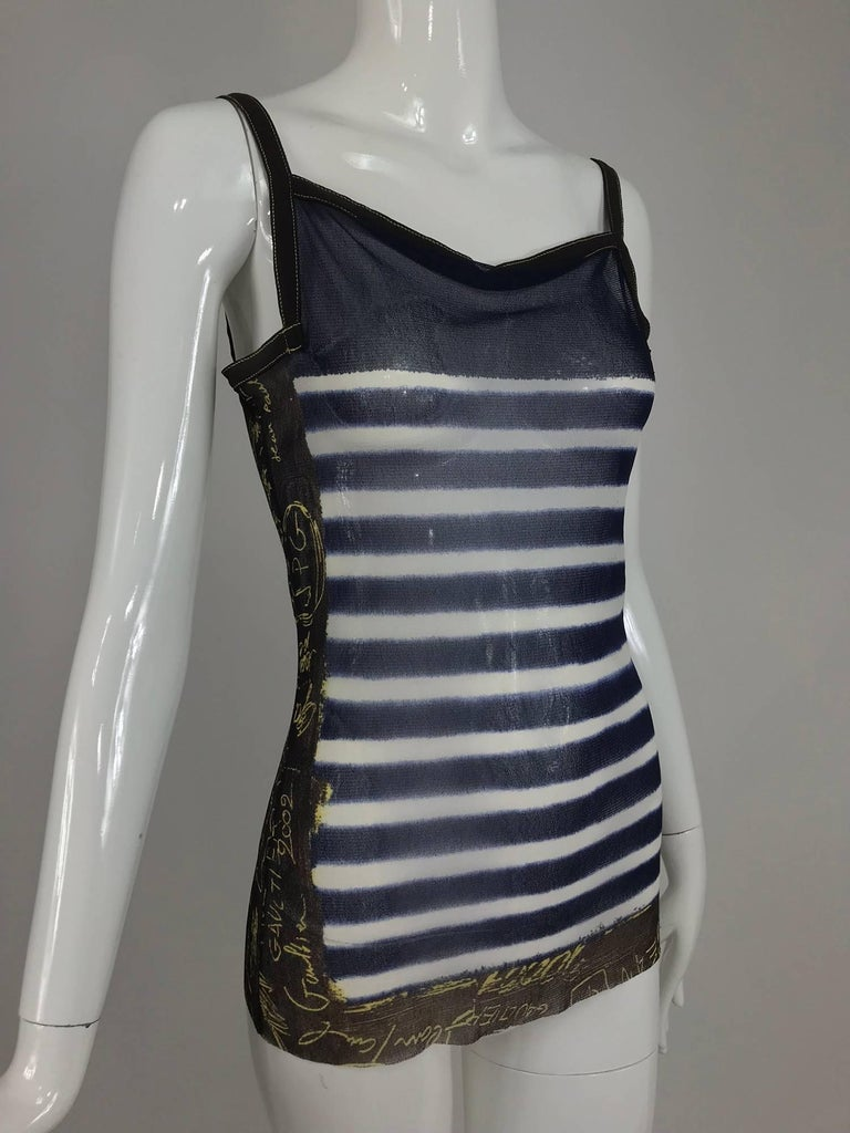 Jean Paul Gaultier nautical stripe tank top signed and dated 2001-2002. Mesh top has higher neck front and back with square shape arm openings...Blue and white stripe with vertical bands of brown and white at the sides with signed dated print.