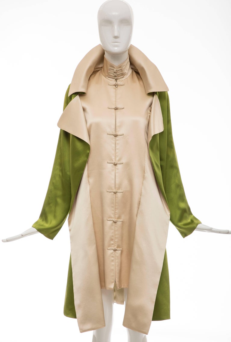 Jean Paul Gaultier, Autumn-Winter 2010 silk charmeuse dress coat with dual welt pockets, toggle closures at front and concealed zip closure at front.  Bust: 36, Waist 36, Shoulder 16, Length 39, Sleeve 23.5