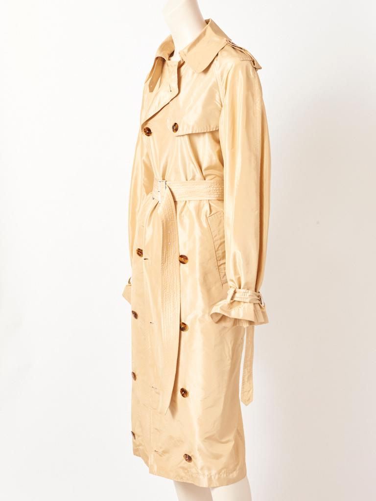 Jean Paul Gaultier, tissue taffeta classic style, double breasted, light beige tone, trench, having a silhouette that narrows.