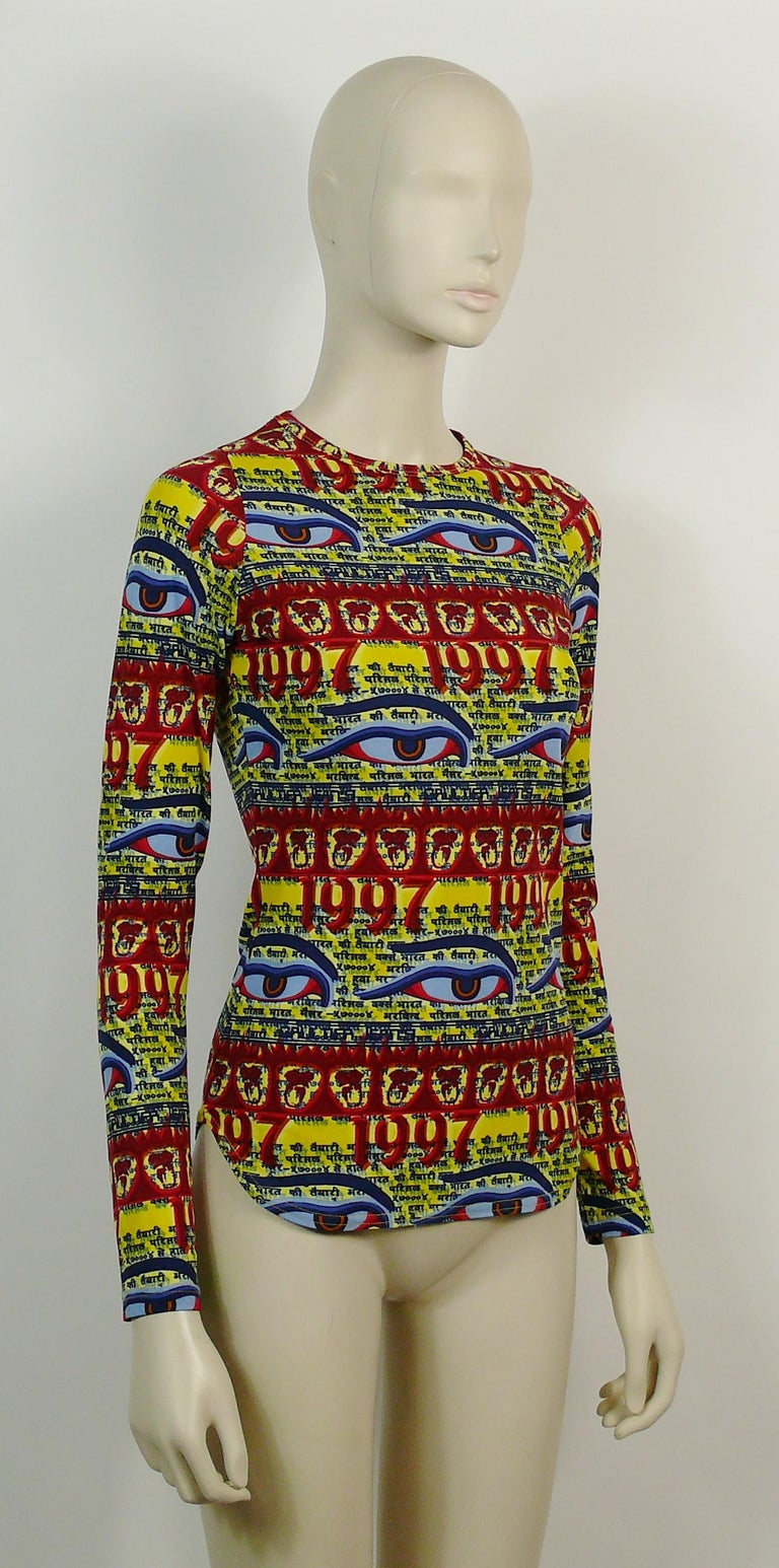 JEAN PAUL GAULTIER vintage 1997 top featuring multicolored Buddha Eyes and Tibetan words print on a yellow background.  Label reads GAULTIER JEAN'S.  Size tag reads : 38. Please refer to measurements.  Missing composition tag. Fabric has some