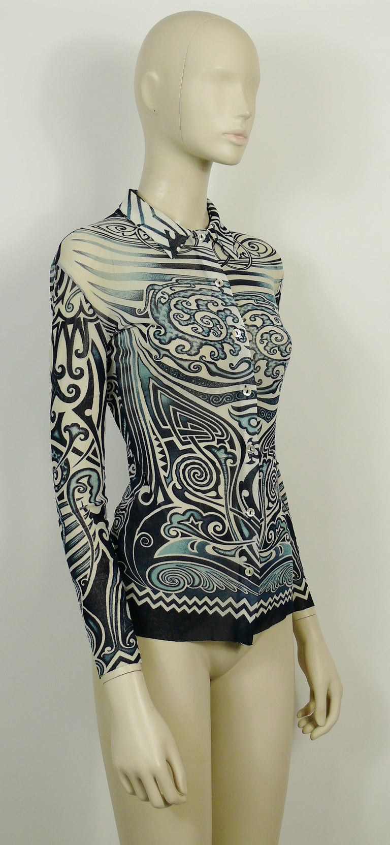 JEAN PAUL GAULTIER vintage FUZZI sheer mesh shirt featuring a tribal tattoo print in shades of blue and white.  Label reads JEAN PAUL GAULTIER MAILLE. MADE IN ITALY.  Size label reads : S. Please refer to measurements.  Composition label reads :