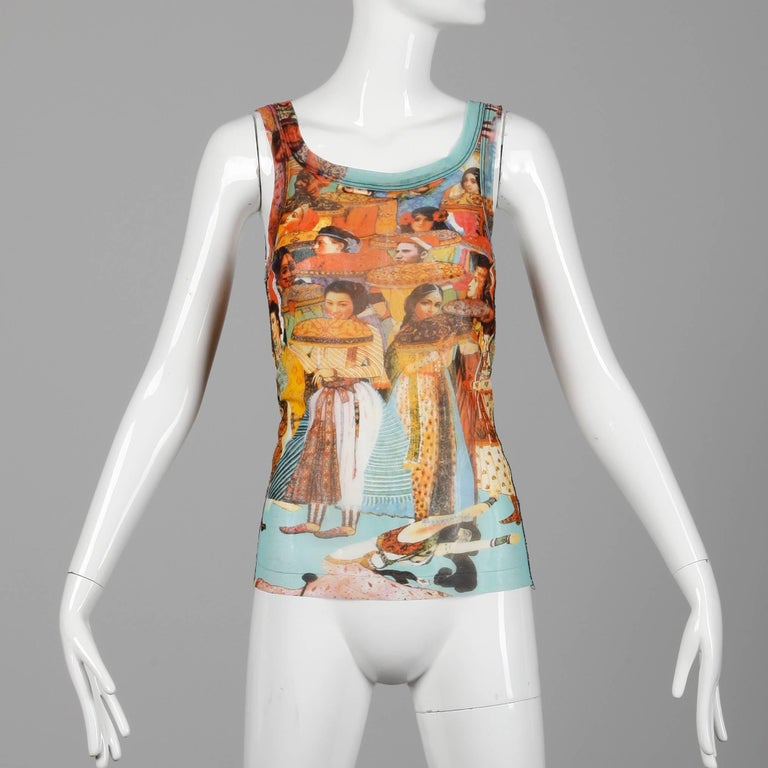 Jean Paul Gaultier mesh tank top in iconic Asian + Indian face and people print. Unlined with no closure (pulls on over the head). The marked size is medium, but this will also likely fit a small and a large as well due to the stretch of the fabric.