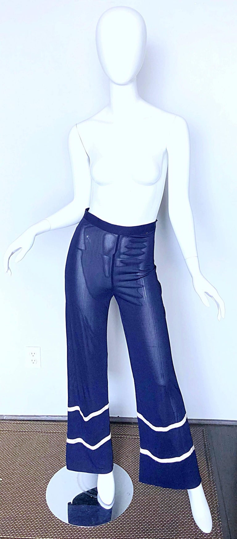 Chic 1990s JEAN PAUL GAULTIER navy blue and white semi sheer rayon jersey nautical wide leg trousers! From the rare Jean Paul Gaultier Classique label. Features a luxurious semi sheer stretch rayon jersey. Two horizontal white ribbons at the hem.