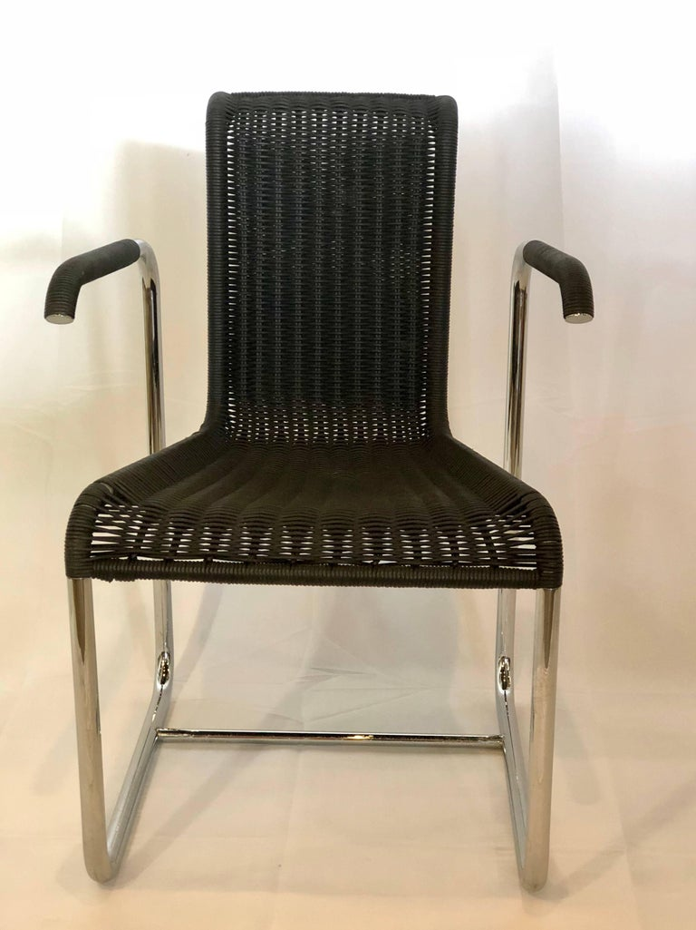 Jean Prouvé D20 stainless steel leather wicker chair has been reproduced by Tecta who is a Furniture Company based in Germany. Beautifully made and very comfortable this black leather hand braided wicker is a perfect accent piece for a desk.