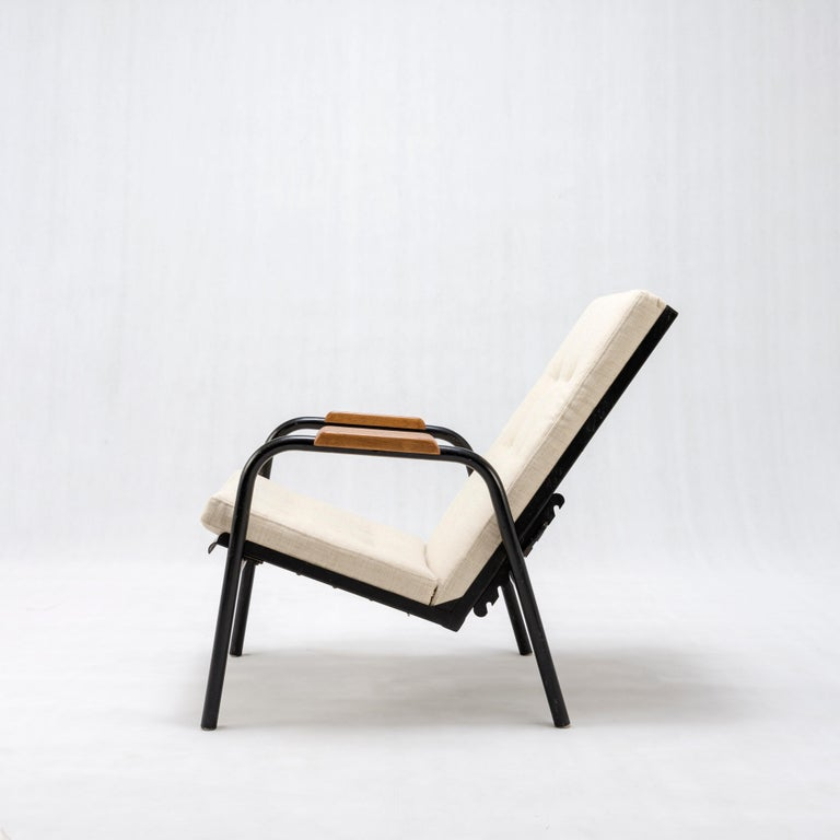 Jean Prouvé armchair with reclining system Provenance: Religious Community of Lorraine Black painted metal, wood Reupholstered in beige linen France, circa 1950.