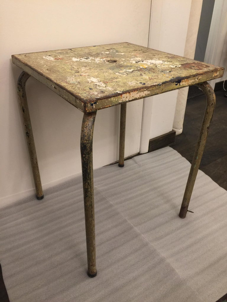 Beautifully distressed through the years of being outside and earning a rich patina. This Jean Prouvé attributed table reminds me of Jackson Pollock painting. This table will make a great side table or game table, just stunning!