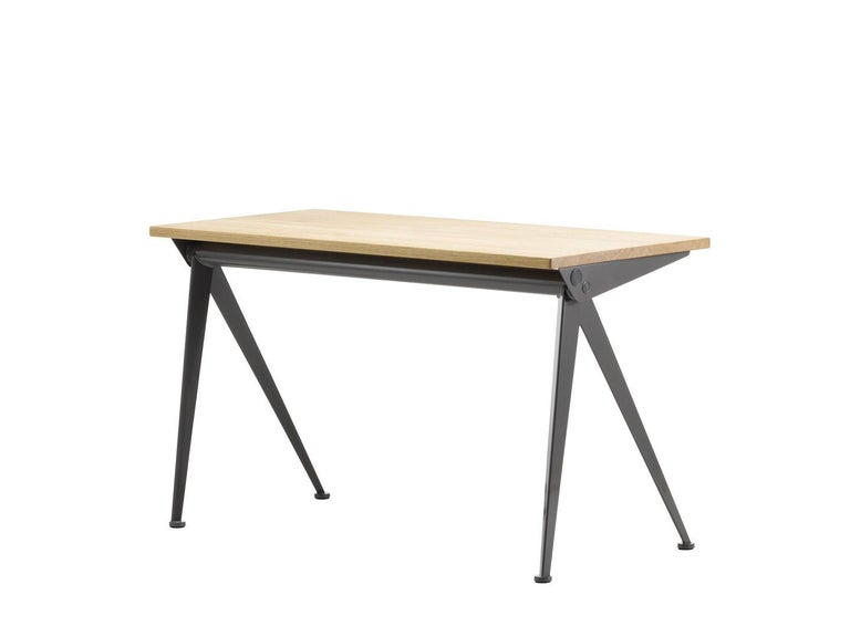 Desk designed by Jean Prouvé in 1953. Manufactured by Vitra, Switzerland.  The slender, elegantly splayed metal legs of the Compas Direction desk by Jean Prouvé call to mind the hinged arms of a compass – 'le compas' in French. Their design is
