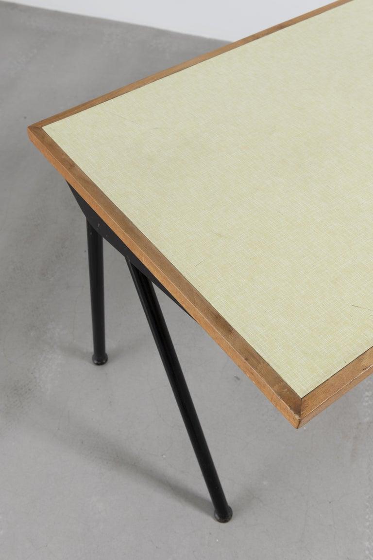Bent sheet steel, steel tube and laminated wood Measures: H. 72.5 x L. 140 x P. 66 cm H. 28.54 x L. 55.12 x D. 25.98 inches  Provenance : Cité Universitaire, Antony, France.